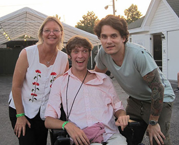 Zach, his mother Susan and musician John Mayer