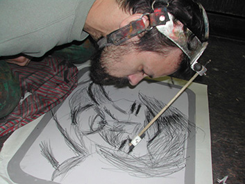 Dan Keplinger creates charcoal drawing