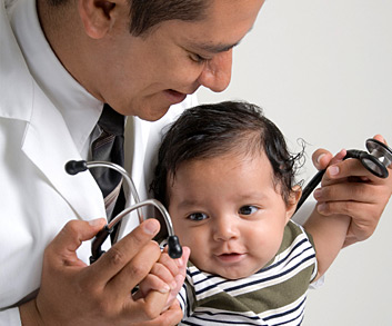 doctor checking child's reflex
