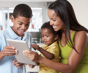 mother sharing information with children on a tablet
